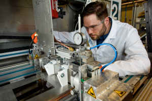 Dr. Scott Hammond, SolarWindow Technologies' Principal Scientist, prepares equipment for processing.